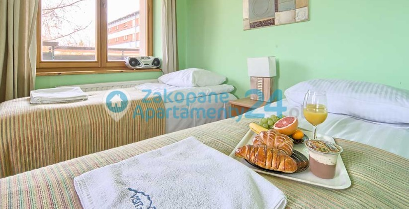 sypialnia dla dwóch osób w apartamencie w Zakopanem
