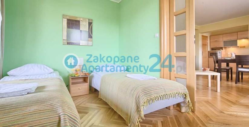 dwusosobowa sypialnia w apartamencie w Zakopanem